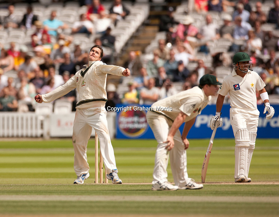 Marcus North (6 for 55) bowls (past overlooked spinner Steve Smith, right) during the MCC Spirit of Cricket Test Match between Pakistan and Australia at Lord's.  Photo: Graham Morris (Tel: +44(0)20 8969 4192 Email: sales@cricketpix.com) 16/07/10
