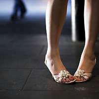 Close up of young adult female wearing high heeled shoes in the street