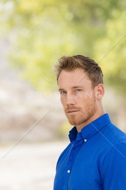 Portrait of a handsome All American man outdoors