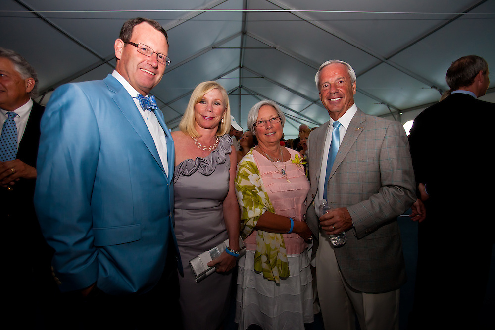 SARASOTA, FL -- May 20, 2011 -- Bob and Kathy Smith, left, pose with Wanda and Roy Williams, head coach of North Carolina, during the 6th Annual Dick Vitale Gala at the Ritz-Carlton Sarasota on May 20, 2011.  Money raised goes to the V Foundation for cancer research.   (PHOTO / CHIP LITHERLAND)