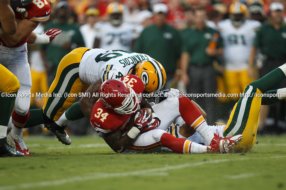 August 29, 2013: Kansas City Chiefs running back Knile Davis (34) is tackled during the Kansas City Chiefs 30-8 preseason victory over the Green Bay Packers at Arrowhead Stadium in Kansas City, Missouri.