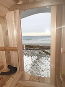 Beach break! The luxurious $16,400 Surf Sauna where surfers can warm up in style after a day on a snowy beach<br /> <br /> It's the answer to winter surfers' prayers - a sauna waiting for them at the edge of the water.<br /> After a day in bitterly cold waves, this new mobile concept is being billed as the perfect way to warm up and dry off away from snowy beaches.<br /> The flagship Surf Sauna, which took years to design and build, is now on sale in New Hampshire, US, for $16,400 (£9,800), and the company plans to create more to rent by the day for $190 (£115).<br /> <br /> Boasting temperatures that reach 90C, each Surf Sauna is bespoke and can accommodate from two to eight people, with options including a changing tent and shower, surf racks, and wood-fired stove. <br /> Ross Beane, Surf Sauna spokesman, said the company will have them in other locations soon, but currently serves North Eastern US.<br /> He added: 'Our aim with Surf Sauna is to create a warming place that builds community with cold weather surfers. <br /> <br /> 'The sauna is a crucial part of utilizing the entire day for winter surf sessions. The inside smells of rich cedar and is very cozy. <br /> 'We often bring music in the sauna and relax with friends. The sauna reaches up to 190F so even the coldest surfer can warm up inside quickly. <br /> 'The product is our original idea and after extensive research we found our product to be the only one of its kind with the surf sauna branding.'<br /> <br /> The Surf Sauna is made out of Western Red Cedar which is naturally rot resistant and antimicrobial.<br /> The chassis and hardware are produced from marine grade galvanised and stainless steel to hold up to years of salt water exposure. <br /> Every Surf Sauna comes bundled with a mounted shovel and hi-lift jack aimed at helping surfers get unstuck after pulling it to your favorite secret spot.<br /> ©Surf Sauna/Exclusivepix