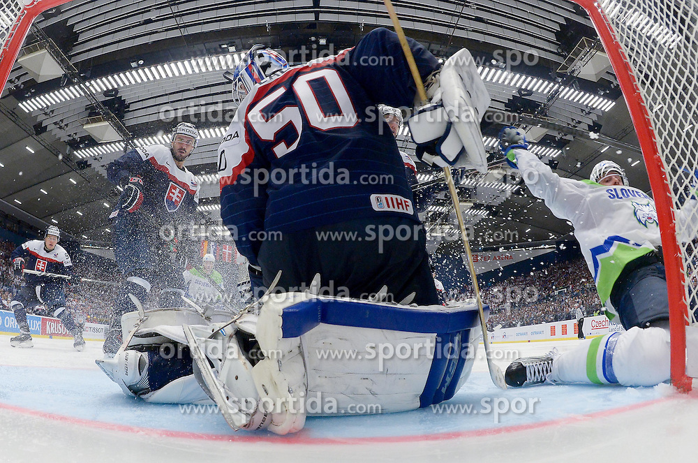 Jan Mursak of Slovenia (R) vs Jan Laco of Slovakia during Ice Hockey match between Slovakia and Slovenia at Day 5 in Group B of 2015 IIHF World Championship, on May 5, 2015 in CEZ Arena, Ostrava, Czech Republic. Photo by Vid Ponikvar / Sportida