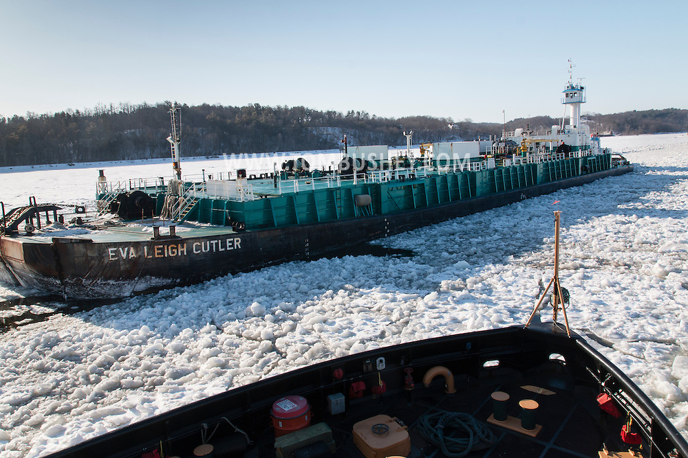 The Coast Guard icebreaker Sturgeon Bay passes the Eva Leigh Cutler, an oil tank barge, on the Hudson River south of Hudson, New York.