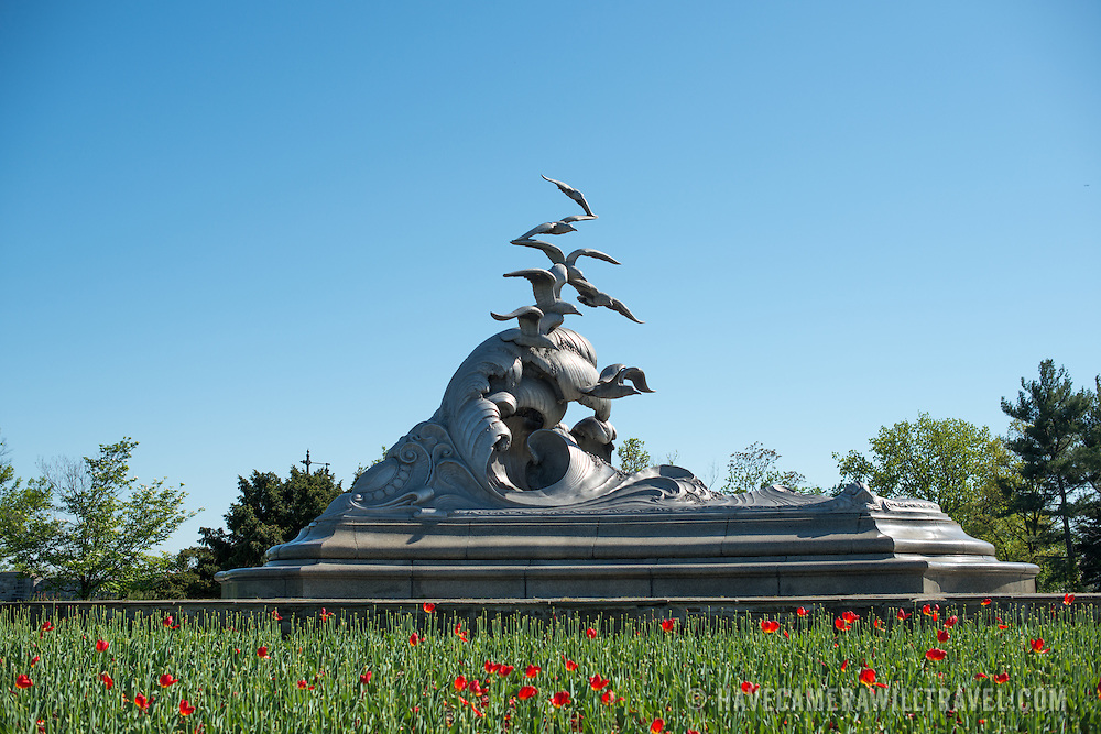 Wide shot of the Navy-Merchant Marine Memorial in Arlington, Virginia, on Columbia Island on the banks of the Potomac across from Washington DC. The memorial honors those who lost their life at sea in World War I and was dedicated in 1934. The main sculpture is cast from aluminum.