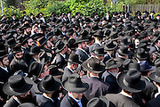 After the funeral of Rabbi Josef Dunner who died on the 1st of April 2007 hundreds of people follow the car carrying the coffin on its way to the cemetery.  Rabbi Dunner was one of the last German Jewish Orthodox Rabbis ordained before the holocaust and well respected within the local community.
