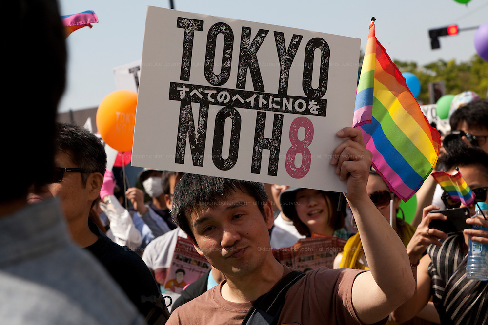 """A """"Tokyo, No Hate"""" sign at Tokyo Rainbow Pride festival, Yoyogi Park, Tokyo, Japan. Sunday April 27th 2014 This was the third year this annual gay-pride event has been held in Japan capital.with food, fashion and health care stalls and musical performances set up in Yoyogi Park event square and a colourful parade around Shibuya at 1pm."""
