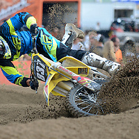 Laura Stoecker/lstoecker@dailyherald.com<br /> Ross Martin, 28,  of Burlington, WI, tips his bike in the deep dirt of a bend and loses his first place lead in the 250 A class race at the motocross racing event at the McHenry County Fair in Woodstock on Friday, August 2. Martin has been racing since he was nine years old.