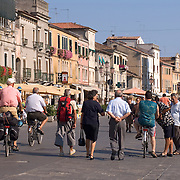 People strolling down main street in Chioggia Italy
