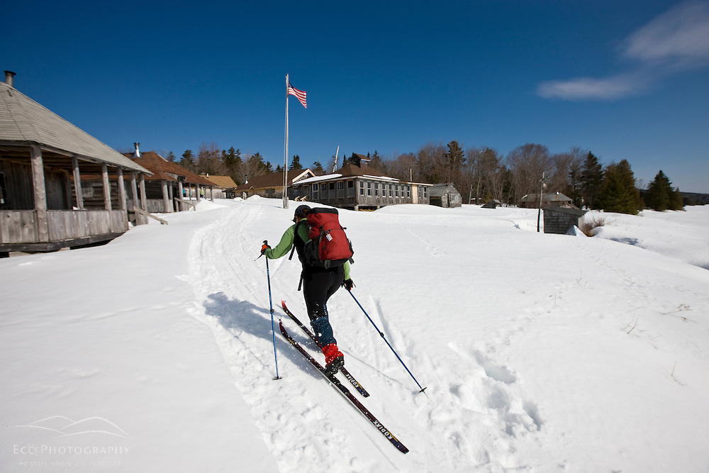 A woman cross-country skiing at West Branch Pond Camps near Greenville, Maine.