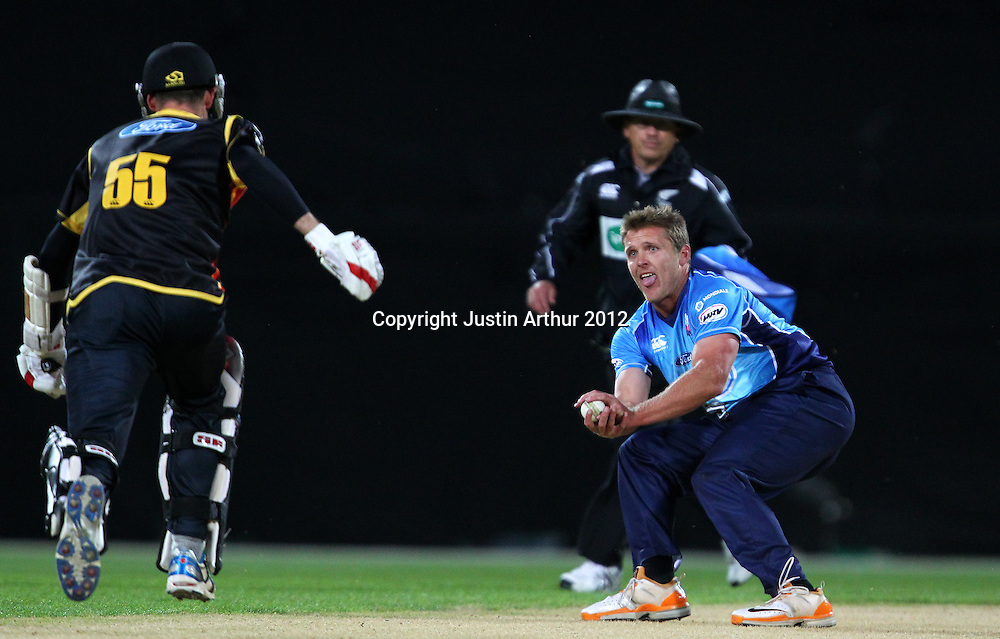 Aces' Michael Bates fields off the batting of Firebirds' Andy McKay during the 2012/2013 HRV Cup Twenty20 session. Wellington Firebirds v Auckland Aces at Westpac Stadium, Wellington, New Zealand on Friday 16 November 2012. Photo: Justin Arthur / photosport.co.nz