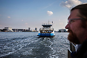 In Amsterdam vaart een veerboot van de GVB van de NDSM haven over het IJ.<br /> <br /> A ferry sails at the IJ in Amsterdam.