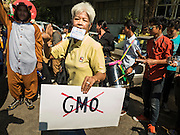 09 DECEMBER 2015 - BANGKOK, THAILAND:  People rally against GMO crops in Bangkok. About 50 environmental activists met near Government House in Bangkok to protest against the Biological Safety Bill being debated in the Thai legislature. The bill will allow use of genetically modified organisms (GMOs) for commercial purposes. Political gatherings of more than five people are prohibited by the military government and the protestors were not allowed to march to Government House or directly confront legislators.    PHOTO BY JACK KURTZ