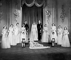 Princess Elizabeth and the Duke of Edinburgh with their eight bridesmaids in the Throne Room at Buckingham Palace.