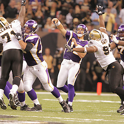 2008 October, 06: Minnesota Vikings quarterback Gus Frerotte (12) throws a 33-yard touchdown pass to Bernard Berrian (87) (not pictured) that tied the game at 27-27 in the fourth quarter against the New Orleans Saints at the Louisiana Superdome in New Orleans, LA.