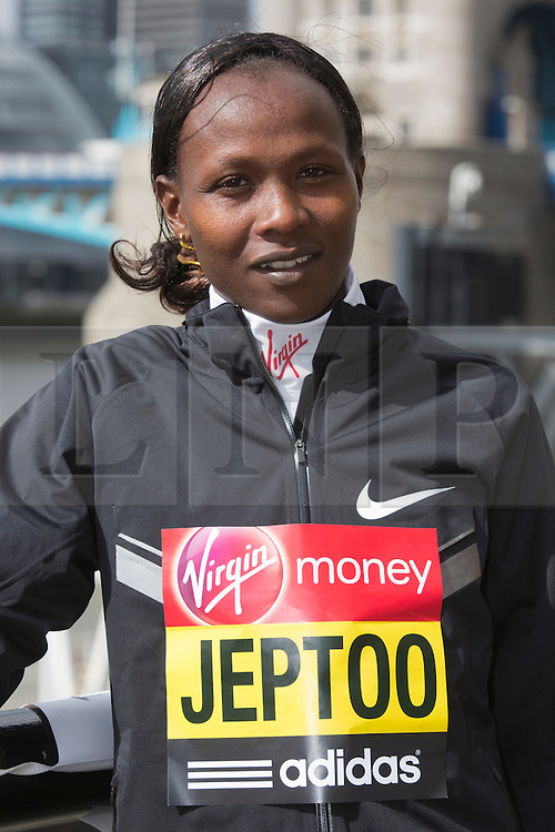 © Licensed to London News Pictures. 18/04/2013. London, England. Pictured: Kenyan Runner Priscah Jeptoo. Virgin London Marathon - Photocall with International Women Runners Athletes Tiki Gelana (ETH), Edna Kiplagat (KEN), Priscah Jeptoo (KEN) and Yoko Shibui (JPN) at Tower Bridge ahead of Sunday's run, London. Photo credit: Bettina Strenske/LNP