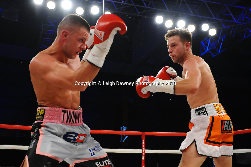 Chris Jenkinson & Adam Battle in a Light Middleweight contest. Glow, Bluewater, Kent, UK. Hennessy Sports © Leigh Dawney Photography 2013.
