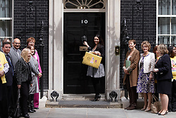 © licensed to London News Pictures. LONDON, UK  12/05/2011. Actress Martine McCutcheon (C) hands over a petition, signed by nearly 750,000 Britons, to 10 Downing Street calling on the Government to provide greater care and protection for child victims of trafficking. Please see special instructions for usage rates. Photo credit should read CLIFF HIDE/LNP