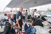 A SCUBA diving club in Larnaca, Cyprus. Divers are readying their equipment on the dive boat before leaving for sea