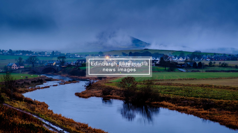 Tinto Hill and the village of Thankerton in South Lanarkshire, Scotland shrouded in low cloud on the evening of 2nd December 2018<br /> <br /> (c) Andrew Wilson   Edinburgh Elite media