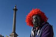 A demonstrator passes Nelson's Column in Trafalgar Square during the Time To Act, National Climate March organised by Campaign Against Climate Change in London, England on March 7, 2015