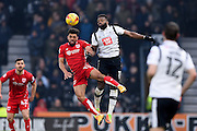 Bristol City defender Scott Golbourne (13) battles in the air with Derby County forward Darren Bent (11) during the EFL Sky Bet Championship match between Derby County and Bristol City at the Pride Park, Derby, England on 11 February 2017. Photo by Jon Hobley.