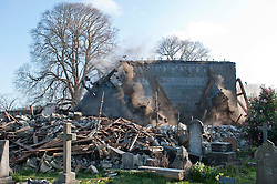 Demolition workers bring down the roof of Holy Trinity Avonside,  built in 1867, one of the oldest Anglican churches to be destroyed in the earthquakes, Christchurch, New Zealand, Wednesday, September 21, 2011. Credit: SNPA /  David Alexander.
