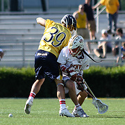 Denver Attacker Zach Miller (33), RIGHT,  perpares to retrieve the ball as Drexel Defender Paul Harrison (39), LEFT,  defends in the second half of The NCAA Division I Men's Lacrosse Tournament game between the No. 5 seed Denver and No. 12 ranked Drexel Sunday, May. 18, 2014 at Delaware Stadium in Newark, DEL