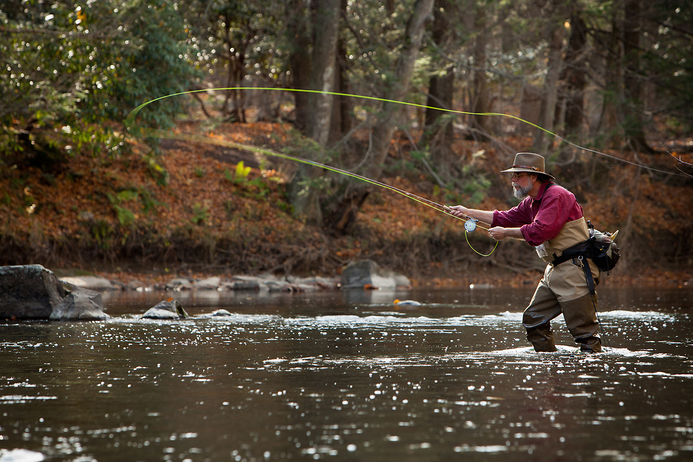 Penns Creek fly fishing guide, Tom  Doman casting for trout on Penns Creek, Pennsylvania