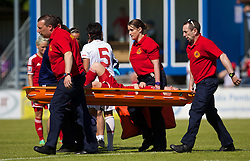 HAVERFORDWEST, WALES - Saturday, June 14, 2014: Wales' Hayley Ladd lies injured against Turkey during the FIFA Women's World Cup Canada 2015 Qualifying Group 6 match at the Bridge Meadow Stadium. (Pic by David Rawcliffe/Propaganda)