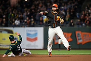San Francisco Giants shortstop Brandon Crawford (35) throws the ball to first base against the Oakland Athletics at AT&T Park in San Francisco, California, on March 26, 2018. (Stan Olszewski/Special to S.F. Examiner)