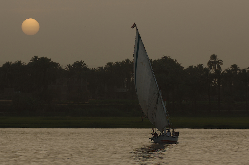 Felluca (traditional boat) sailing in the Nile river, Egypt.