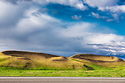 These crater groups on the lake shore near Myvatn, Iceland, were formed by steam explosions when glowing lava poured into a lake.  The various forms of the craters tell how they took shape as the steam eruptions continued | Denne gruppen av krater langs vannkanten ved Myvatn på Island wart forma av dampeksplosjoner når glødende lava rant ned i innsjøen. De ulike formene på kraterene forteller hvor de vart forma av damputbrudda.