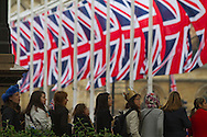 A crowd of onlookers in Parliament Square, London, awaiting the arrival of guests and members of the British royal family prior to the wedding of Prince William to Catherine Middleton. The wedding was held at Westminster Abbey. Tens of thousands of people lined the streets to wish the couple well before and after the ceremony.