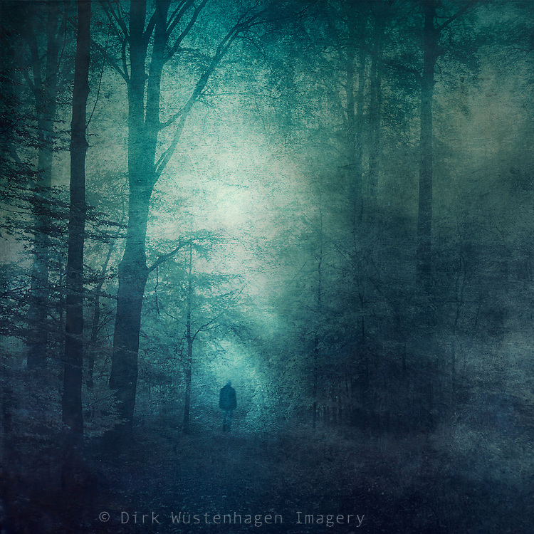 Man going towards a light tunnel in a forest. <br /> Texturized &amp; manipulated photograph