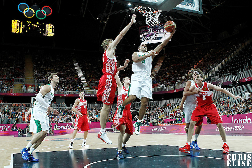 02 August 2012: Brazil Alex Garcia goes for the layup past Andrei Kirilenko during 75-74 Team Russia victory over Team Brazil, during the men's basketball preliminary, at the Basketball Arena, in London, Great Britain.