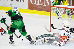 23.10.2012. Hala Tivoli, Ljubljana, SLO, EBEL, HDD Telemach Olimpija Ljubljana vs HC TWK Innsbruck Die Haie, 15. Runde, in picture Kevin De Vergilio (HDD Telemach Olimpija, #51) scores on Patrick Machreich (Innsbruck Die Haie, #33) during the Erste Bank Icehockey League 15th Round match between HDD Telemach Olimpija Ljubljana and HC TWK Innsbruck Die Haie at the Hala Tivoli, Ljubljana, Slovenia on 2012/10/23. (Photo By Matic Klansek Velej / Sportida)