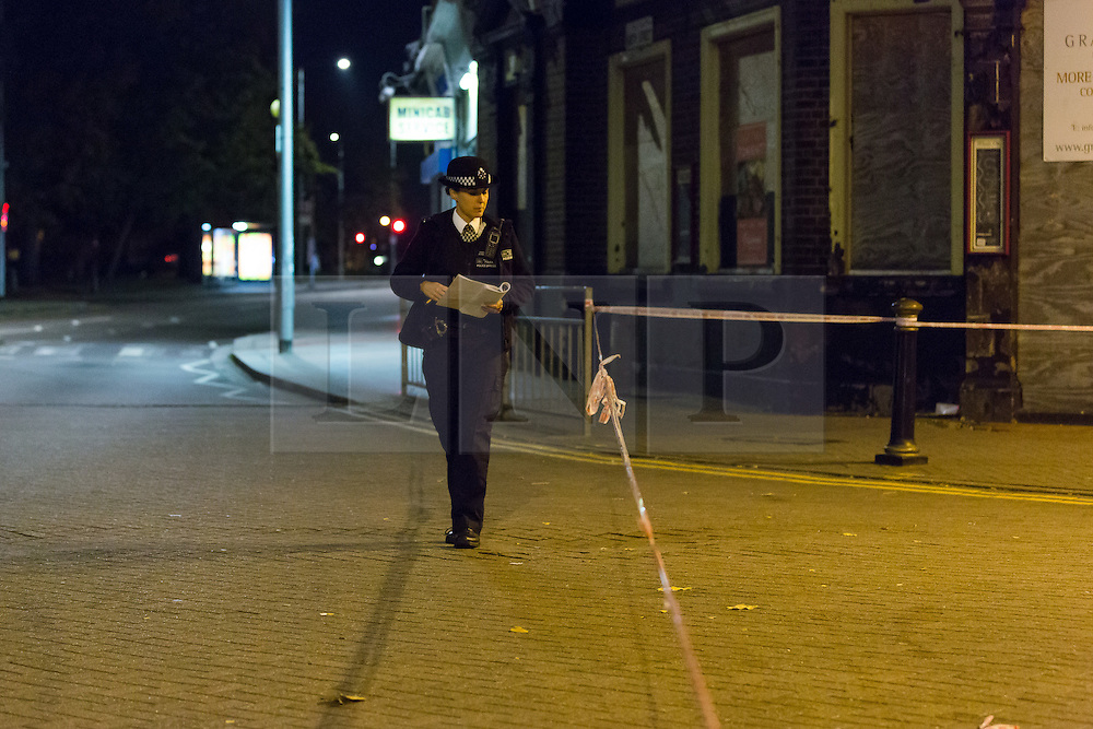 © Licensed to London News Pictures. 26/10/2016. LONDON, UK.  A police officer at the police cordon around East Street in Barking, east London. Police were called at 18:12 on Wednesday 26th October. Officers and the London Ambulance Service attended the scene and found a man in his late 20s with stab wounds to the abdomen. He was taken to an east London hospital where he remains with life threatening injuries.  Photo credit: Vickie Flores/LNP