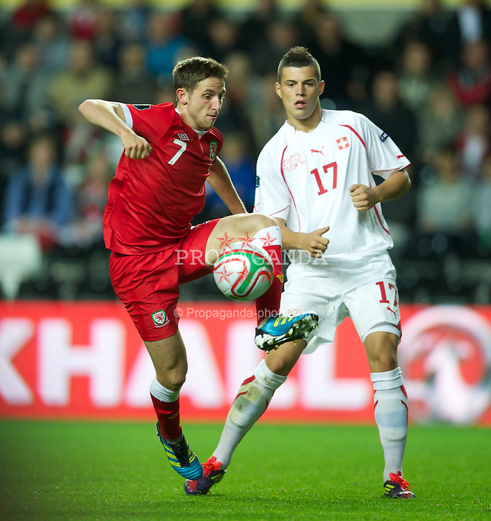 SWANSEA, WALES - Friday, October 7, 2011: Wales' Joe Allen in action against Switzerland's Granit Xhaka during the UEFA Euro 2012 Qualifying Group G match at the Liberty Stadium. (Pic by David Rawcliffe/Propaganda)