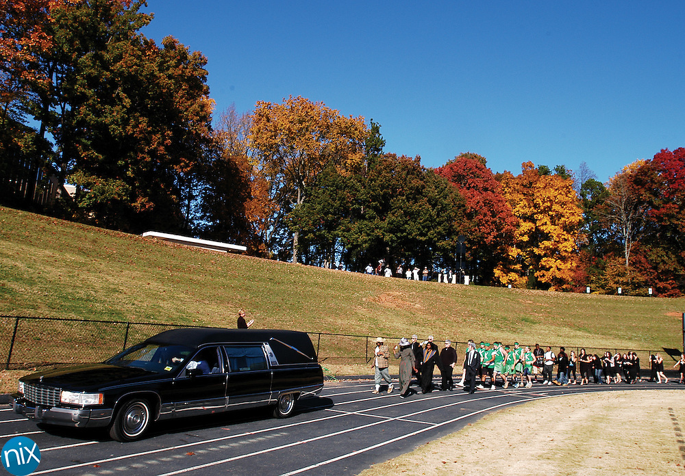 "Concord High School students put on a mock funeral where they ""layed to rest"" the Wonder, the mascot of rival A.L. Brown High School in Kannapolis, Thursday afternoon. Concord will host Kannapolis tonight in the annual Battle of the Bell game."
