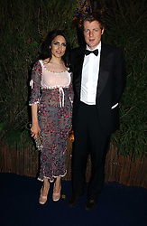 ZAC GOLDSMITH and RENU MEHTA founder of Fortune Forum at the British Red Cross London Ball held at The Room by The River, 99 Upper Ground, London SE1 on 16th November 2006.<br />