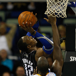 January 12, 2011; New Orleans, LA, USA; Orlando Magic center Dwight Howard (12) shoots over New Orleans Hornets power forward David West (30) during the second quarter at the New Orleans Arena.   Mandatory Credit: Derick E. Hingle