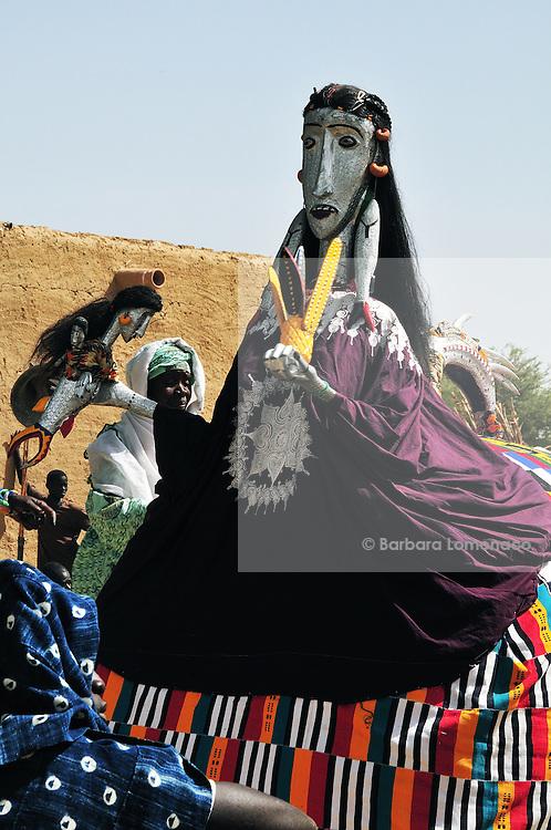 Diajo entering the village