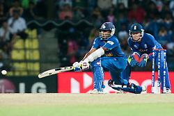 © Licensed to London News Pictures. 01/10/2012. Sri Lankan Mahela Jayawardene plays a reverse sweep shot during the T20 Cricket World super 8's match between England Vs Sri Lanka at the Pallekele International Stadium Cricket Stadium, Pallekele. Photo credit : Asanka Brendon Ratnayake/LNP