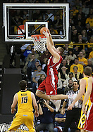 January 19 2013: Wisconsin Badgers forward/center Jared Berggren (40) dunks the ball as Iowa Hawkeyes forward Zach McCabe (15) looks on during the first half of the NCAA basketball game between the Wisconsin Badgers and the Iowa Hawkeyes at Carver-Hawkeye Arena in Iowa City, Iowa on Sautrday January 19 2013. Iowa defeated Wisconsin 70-66.