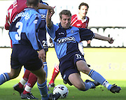 Nationwide Division 2 27-10-2001.Wycombe Wanderers FC v Swindon Town FC:.Mark  Rogers, tackles  Danial Invincibl e, as Swndon attack. ... ...........