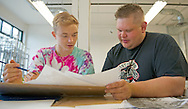 Nathan Maliscke receives professional advice from Bill Thompson, the instructor for the Plains Art Museum's drawing comics course on Friday, July 11, 2014, in Fargo, N.D. Thompson has been making art for seven years, most recently, he designed game board products for the Game of Thrones.<br /> Nick Wagner / The Forum