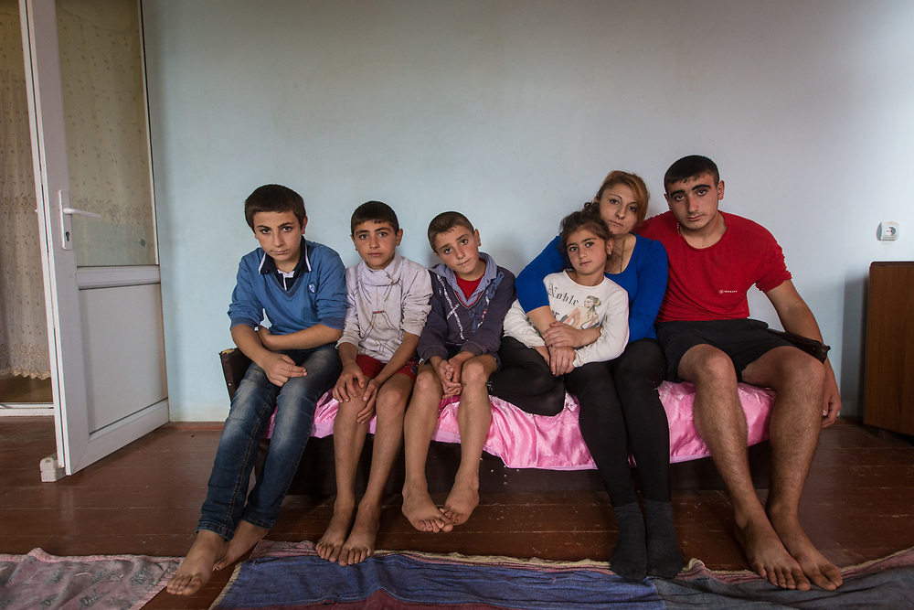 Anna poses with five of her ten kids. The Nagorno Karabakh government gives a free house to each family upon the birth of their 6th child. This family received a second house upon the birth of their tenth child. What Armen and Anna really wanted was a daughter, and they finally got one after nine tries.     © Daniel Barreto Mezzano
