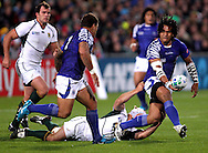© Andrew Fosker / Seconds Left Images 2011 - Maurie Faasavalu of Samoa passes one handed to  Mahonri Schwalger (c) South Africa v Samoa - Rugby World Cup 2011 - North Harbour Stadium - Auckland - New Zealand - 30/09/2011 -  All rights reserved..