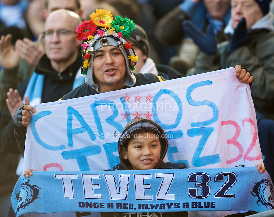 MANCHESTER, ENGLAND - Sunday, January 31, 2010: Manchester City fans show their support for Carlos Tevez before the Premiership match at the City of Manchester Stadium. (Photo by David Rawcliffe/Propaganda)